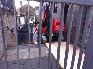 Platform-Basket-30T-PRO_Tracked_Spider_Machine_Outdoors_Stairway